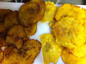 You can see the difference between the end result of double frying the ripened plantain {yellow/blackened peel} on the left versus the unripened counterpart {green peel} on the right.