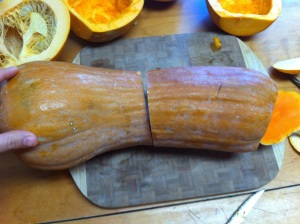 This is a Tahitian Squash.  It has a bright orange flesh, smells like watermelon and has a very sweet taste.  I cut off the top where there aren't seeds and used it for something else...